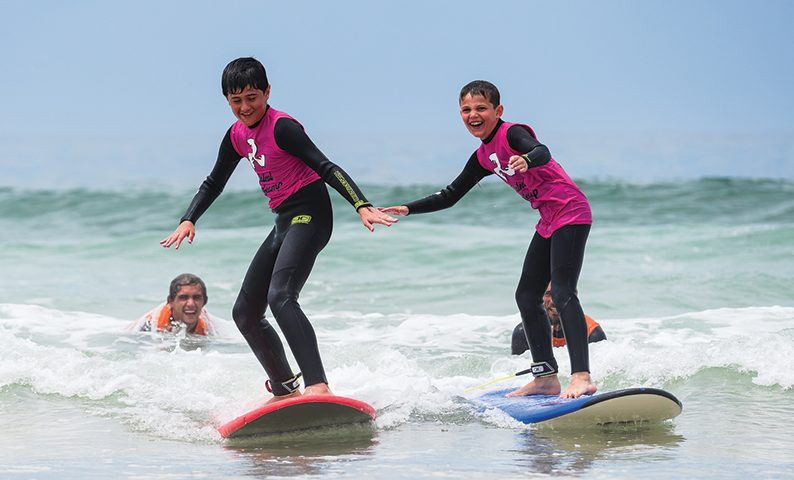 Family-Surf-Camp-Holidays-kids-surfing-baleal-surf-camp
