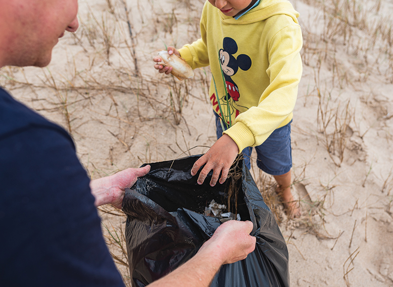 kids-beach-cleaning-at-baleal-surf-camp-peniche-portugal